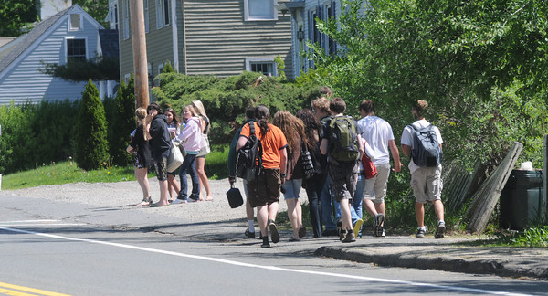 West Newbury:Pentucket students make their way up Main Street in West Newbury Friday morning after being evactuated from the school due to a bomb scare . Jim Vaiknoras/Staff photo