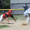 Georgetown: Amesbury's Tyler Smith dives back to second just before being tagged out by Georgetown'sRyan Browner on a pick off play during the championship game at Georgetown of the Bert Spofford Memorial Tournament Sunday. Jjim Vaiknoras/staff photo
