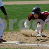Boxford: Newburyport's Kyle LeBlanc dives safetly back to first during the Clippers game against Masconomet Saturday in Boxford. Jim Vaiknoras/Staff photo