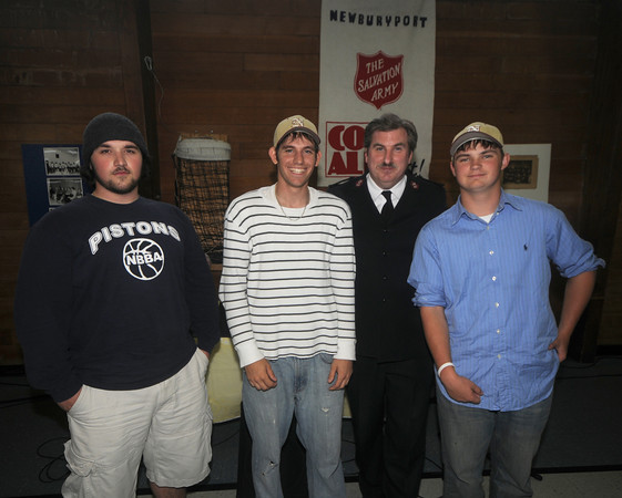 Newburyport: The top  Salvation Army fund raisers in the annual Christmas Bell Ringing Drive, from the left: Devon D'Amrosio, Derek Purvis, and Ben Branfield all seniors at Newburyport high pose with Captain James Purvis at a dinner in their honor last night at the Salvation Army building in Newburyport. Jim Vaiknoras/Staff photo