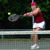 Newburyport: Julie Manning returns a shot against Ipwich Friday at Newburyport. Jim Vaiknoras/Staff photo
