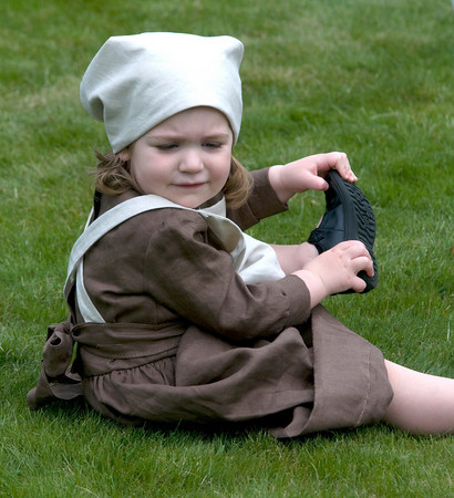 Newbury: Zoe Parker Blumenthol , 2, takes off her shoes while dressed in perion costumn Saturday during Newbury's 375th  celebration on the Lower Green. Jim Vaiknoras/Staff photo