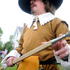 Newbury:Paul Kenworthy of the Salem Trayned Band explains the theory  and practice of 17th century weapons and warfair Sunday  during Newbury's 375th celebration on the Lower Green.He is holding a 16 ft steel tipped ash wood pike. jim Vaiknoras/Staff photo