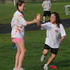 Newburyport:  Cassie Clavin gets a high 5 from Lilah Swain during the Clipper jr practice  at Fuller field in Newburyport. The program has high school track athletes work special needs athlete on track and field skills. Jim vaiknoras/Staff photo