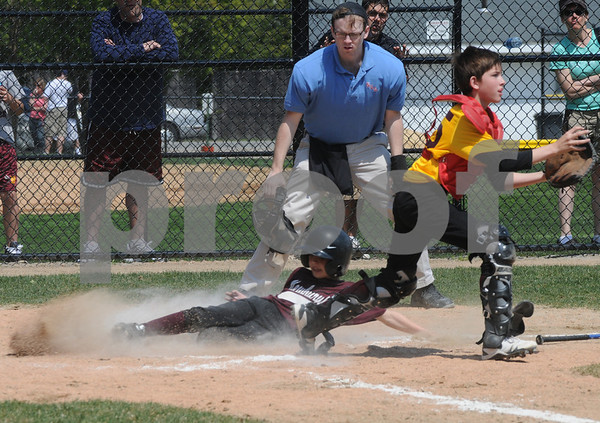 Newburyport:Matt Cote of the Provident Bank waits for the throw home as Caleb Dawe of the North End Boat Club slide safetly on Pioneer League Opening Day Saturday. Jim Vaiknoras/Staff photo