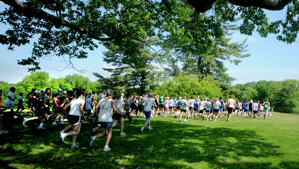 Newburyport: Runners take off in Maudslay State Park for the 10th annual Trav's Trail Run Sunday morning. Jim Vaiknoras/Staff photo