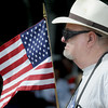 Seabrook:Al Howes Sr holds the flagproudly at the annual Seabrook memorial Day ceremony at Town Hall Sunday morning. Jim Vaiknoras/Staff photo