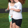 Newburyport:  Molly Abbott runs with Aimee Perlitch during the Clipper jr practice  at Fuller field in Newburyport. The program has high school track athletes work special needs athlete on track and field skills. Jim vaiknoras/Staff photo