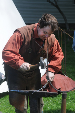 Newbury:Blacksmith Carl Close makes an iron spoon at the Spencer-Peirce-Little Farm in Newbury Sunday at the 15th annual Draft Horse Plow Day. Jim Vaiknoras/Staff photo