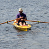 Amesbury: A one man scull, dubbed the Rufus T Firefly makes it way up river at The Mighty Merrimack Rowing Race at Lowell's Boat Shop in Amesbury Sunday afternoon. Jim Vaiknoras/Staff photo
