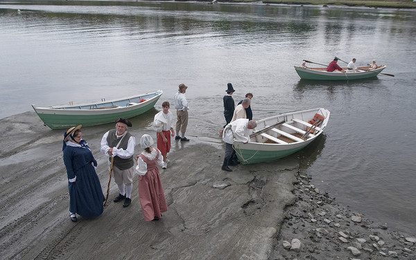 Newbury:  A group of reinactors Saturday come ashore to near the point along the Parker River were the first settlers of Newbury landed in 1635. The landing was part of Newbury's 375th  celebration. Jim Vaiknoras/Staff photo