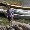 Amesbury; Maya Gastman , 10 of Newburyport walks around near the shore at The Mighty Merrimack Rowing Race at Lowell's Boat Shop in Amesbury Sunday afternoon. Jim Vaiknoras/Staff photo