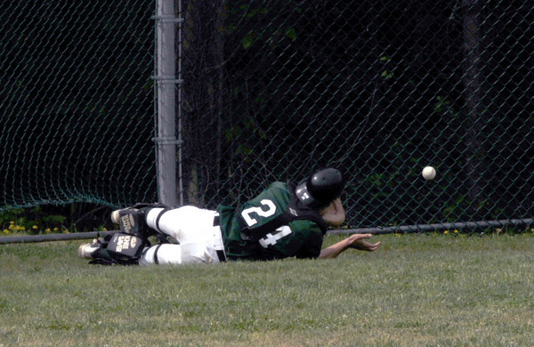 West Newbury: Pentucket's Mike Doud makes a great effort but can't quite come up with a fould ball against Amesbury  at Pentucket Saturday morning. Jim Vaiknoras/Staff photo