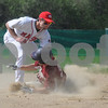 Boxford: Newburyport's Kyle McElroy is out a second on a steal attempt as Masconomet's Chris Splinter puts down the tag during their game at Boxford Saturday . Jim Vaiknoras/Staff photo