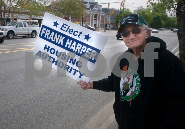 Georgetown: Georgetown resident Phil Tomarscio  holds  a sign in Georgetown Square in support of Houseing Authority candidate Frank Harper. Jim Vaiknoras/Staff photo
