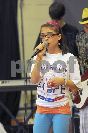 Amesbury Jillian Collins performs with the band Audio Rush at the kick off for the Relay For Life, a fund raiser for the American Cancer Society at the Amesbury Elementary School Saturday. Jim Vaiknoras/Staff photo