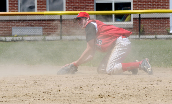 Georgetown: Amesbury 2nd baseman Tyler Lay makes a throw from his knees after a run saving diving stop on a ground ball during the championship game at Georgetown of the Bert Spofford Memorial Tournament Sunday. Jjim Vaiknoras/staff photo