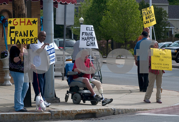 Georgetown: Residents hold signs in Georgetown Square in support of Houseing Authority candidate Frank Harper. Jim Vaiknoras/Staff photo