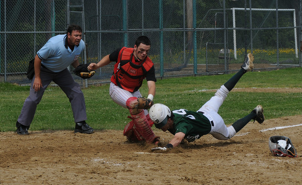 West Newbury: Amesbury's JC Collette tags out Pentucket's Mike Doud at the plate during their game  at Pentucket Saturday morning. Jim Vaiknoras/Staff photo