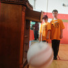 Newburyport: Chris O'Donnell and Michael Maynard demostrate the science behind a curve ball for their project at the Science Fair at the Bresnahan School. The boys tied a string to a ball and twisted it. When the let the ball swing free the string untwisted causing the ball to spin creating a negative air pressure pulling the ball toward it's spin. Jim vaiknoras/Staff photo
