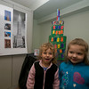 "Newburyport: Cayleigh Laralle, 5, and Alexis Donovan, 3, stand with a sculpture of the Chrysler Building they helped build as part of "" A Head Start on Picturing America ""program at the Seacoast Center in Newburyport. The program used art sent by the NEA to inspire student to create art in various American styles. Jim Vaiknoras/Staff photo"