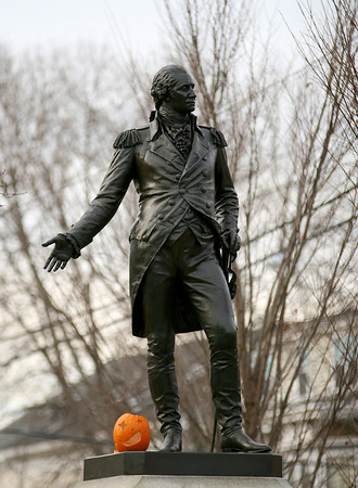 Newburyport: A jack-o-lantern remains at the feet of George Washington's statue on Pond Street in Newburyport, no doubt left over from a michevous trick or treater this past Haloween. Photo by Ben Laing/Staff Photo
