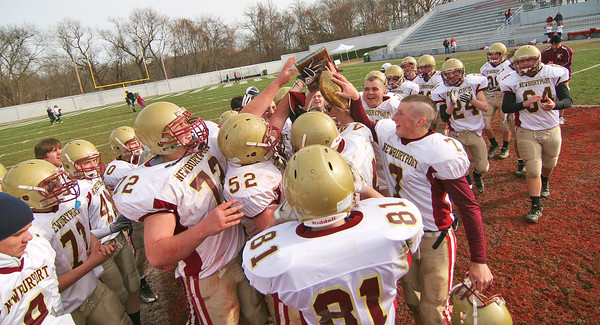 Amesbury: The Newburyport Clippers celebrate with the Chase Trophy after defeating Amesbury 26-0 in Thursday's annual Thanksgiving Day football game. Photo by Ben Laing/Staff Photo