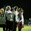 Amesbury: Newburyport players congratulate Cassaundra Davis (13) after she scored the opening goal in Wednesday night's 2-0 win over Wilmington. Photo by Ben Laing/Staff Photo