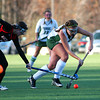Amesbury: Pentucket's Shannon Beaton (24) moves the ball past a Winchester defender during Wednesday's playoff loss at Amesbury Sports Park. Photo by Ben Laing/Staff Photo