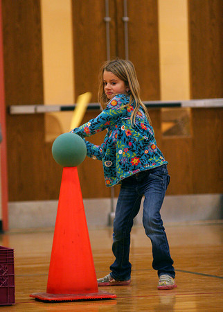 Newbury: Sadie Falconer, a second grader at Newbury Elementary School, takes a swing while playing home run derby in gym class Monday morning. Photo by Ben Laing/Staff Photo