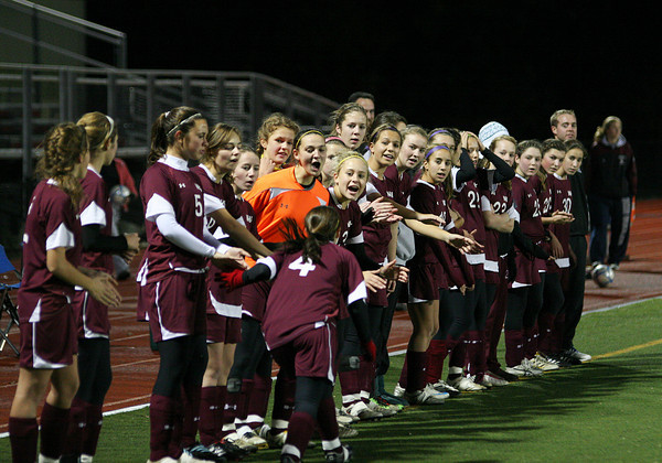 Newburyport: The girls of the Newburyport soccer team give eachother high fives during the announcement of the starting line ups at Wednesday's game in Belmont. Photo by Ben Laing/Staff Photo