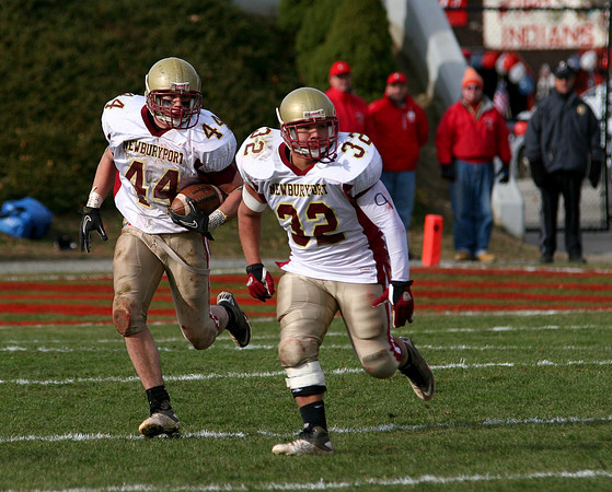 Amesbury: Tyler Martin (32) leads the way for Newburyport running back Dean Cataldo (44) during Thursday's game against Amesbury. Photo by Ben Laing/Staff Photo