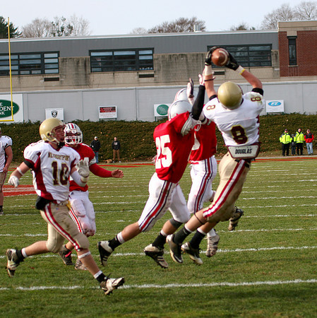 Amesbury: Newburyport's Johnathon Wright (8) makes a leaping catch Thursday as the Clippers defeated Amesbury 26-0. Photo by Ben Laing/Staff Photo