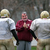 Newburyport: Long time Newburyport football assistant coach, Bob Clarke, works with his players Monday afternoon, preparing them for Thursday's Thanksgiving matchup against Amesbury. Photo by Ben Laing/Staff Photo