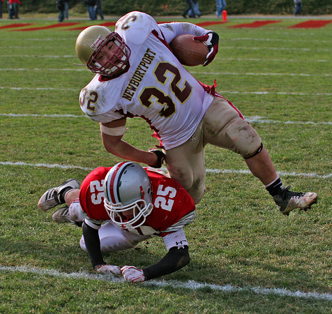 Amesbury: Amesbury's Matthew Enaire (25) cuts the legs out from under Newburyport's Tyler Martin (32) during Thursday's game at Landry Stadium. Photo by Ben Laing/Staff Photo