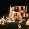 Amesbury: John Edmunds, of Old County Road in Amesbury, has continued his annual Christmas tradition with a new Christmas light show. The show begins nightly at 7pm and donations for the Toys for Tots program are accepted. Photo by Ben Laing/Staff Photo