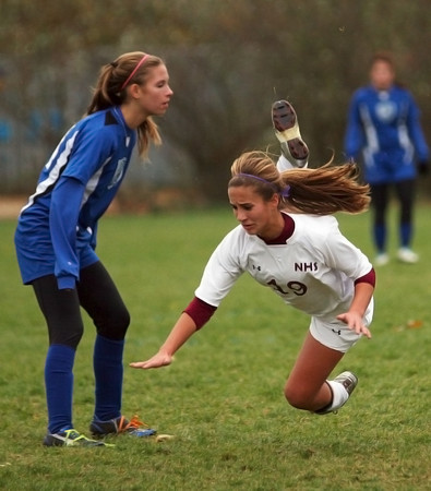 Newburyport: Newburyport's Jaycie Triandafilou (19) gets tripped up during Monday afternoon's 2-0 win over Bedford at Cherry Hill. Photo by Ben Laing/Staff Photo