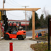 Newburyport: The rail trail got some sprucing up Tuesday morning with the installation of a wooden archway at the Parker Street entrance. The wood was donated by Keiver-Willard, crafted by Mark Richey Woodworking, and installed with the help of Castagna Construction. Photo by Ben Laing/Staff Photo
