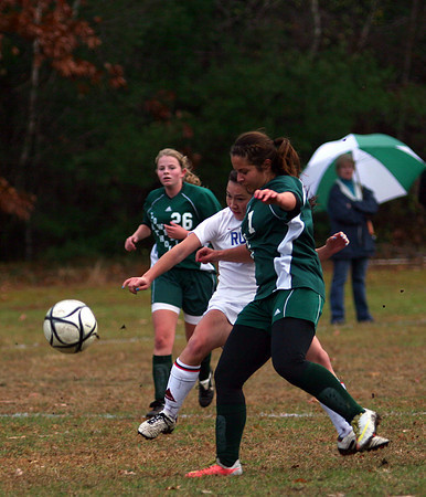 Georgetown: Georgetown's Kelly Chickering (2) is knocked off the ball by a Lowell Catholic defender but not before getting off a shot that would give the Royals a 2-0 advantage early in the first half. Photo by Ben Laing/Staff Photo