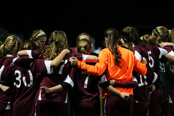 Newburyport: The Newburyport Girls Soccer team huddles up for a pre-game pep talk before the start of Wednesday's game in Belmont. Photo by Ben Laing/Staff Photo