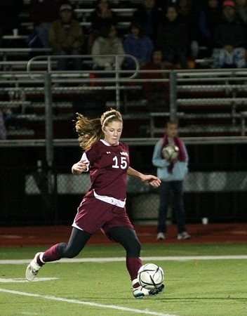 Belmont: Newburyport's Hannah Martin (15) looks to play a long ball during Wednesday night's 1-0 defeat to Belmont in the state tournament. Photo by Ben Laing/Staff Photo