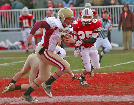 Amesbury:Newburyport quarterback Ryan O'Connor (7) sprints through the Amesbury defense for a 60 yard touchdown on the Clippers opening play in Thursday's 26-0 win over the Indians. Photo by Ben Laing/Staff Photo
