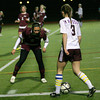 Belmont: Newburyport defender Meghan Corbett (5) closes down Belmont's Marissa Russo (3) during Wednesday night's tournament game. The Clippers season would come to a close with a 1-0 defeat. Photo by Ben Laing/Staff Photo