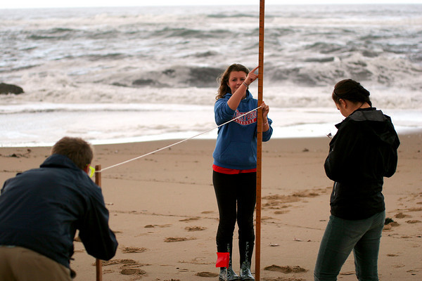 Newbury: Konnar Johnson holds a measuring stick while her classmate Rory Burke takes a reading along a length of rope. Carolyn Hoffman records the groups findings as they meausre the rate of erosion on Plum Island for their class at Governor's Academy. Photo by Ben Laing/Staff Photo