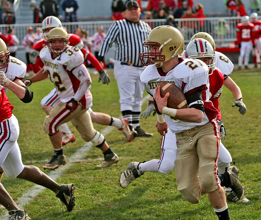 Amesbury: Newburyport's Tyler Cusack (21) sprints through the Amesbury defense on his way to the endzone late in Thursday's game. Cusack's touchdown would seal the 26-0 Clipper victory. Photo by Ben Laing/Staff Photo