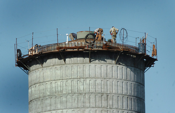 Salisbury: Workers put in rebar atop the new water tower yesterday afternoon after rain gave way to sunshine. The tank is scheduled to be in use by the end of summer next year and will hold 500,000 gallons of water. Bryan Eaton/Staff Photo
