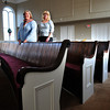 Rev. Joan MacPherson, left, and Lori Townsend, publicity chair of the building campaign, show off the renovated inside of the Main Street Congregational Church in Amesbury. The exterior has been painted, the inside has been cleaned and painted, a new rug put in, the pews refinished and laid with cushioned seating. Bryan Eaton/Staff Photo
