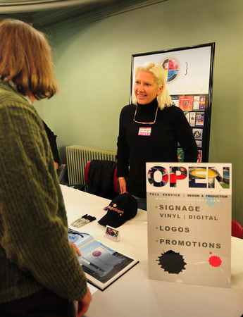 Newburyport: Jen Wright, right, talks about her sign company to Amesbury realtor Nancy Purcell at a Business Expo yesterday at Newburyport City Hall. Bryan Eaton/Staff Photo