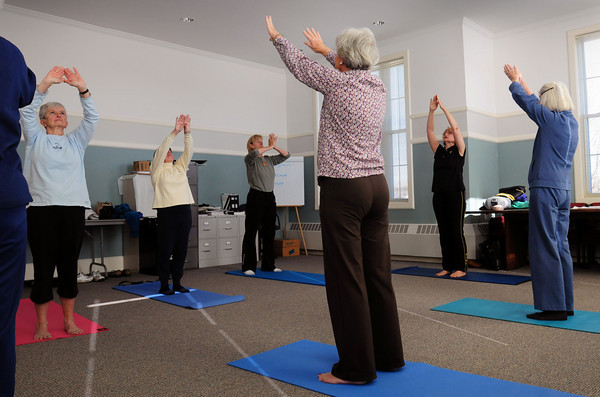 West Newbury: Yoga Instructor is Mary VanAbs, second from right, teaches a class at the 1910 Building in West Newbury. Bryan Eaton/Staff Photo