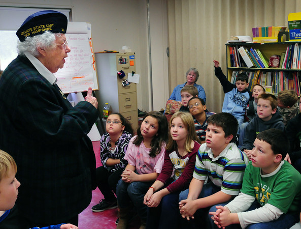 Amesbury: Margaret Nally, who was a US Navy WAVE in World War II, talks about women's role in the service to children at Amesbury Elementary School yesterday. Several others who have served in the military, including Mayor Kezer, also spoke to other classes. Bryan Eaton/Staff Photo